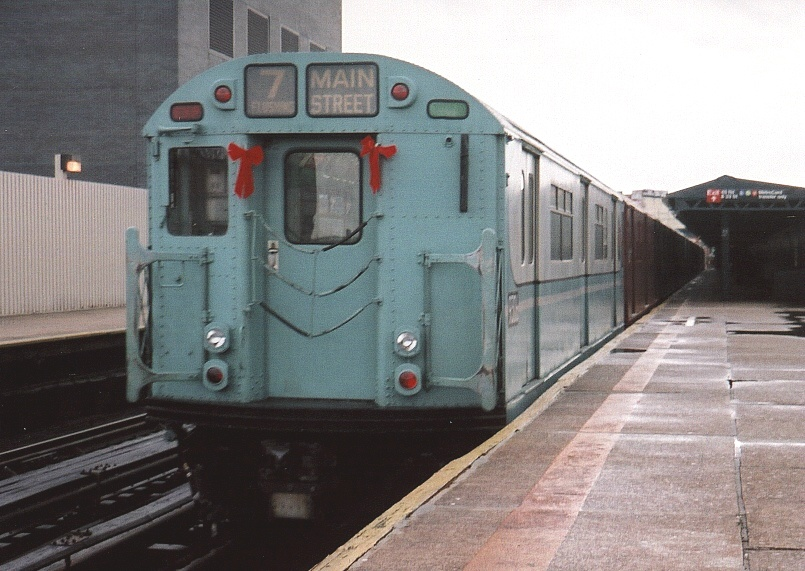 (197k, 805x571)<br><b>Country:</b> United States<br><b>City:</b> New York<br><b>System:</b> New York City Transit<br><b>Line:</b> IRT Flushing Line<br><b>Location:</b> Court House Square/45th Road <br><b>Route:</b> Fan Trip<br><b>Car:</b> R-33 World's Fair (St. Louis, 1963-64) 9306 <br><b>Photo by:</b> Gary Chatterton<br><b>Date:</b> 11/28/2004<br><b>Notes:</b> R33/SMEE train of many colors in holiday 7 line service.<br><b>Viewed (this week/total):</b> 0 / 2297