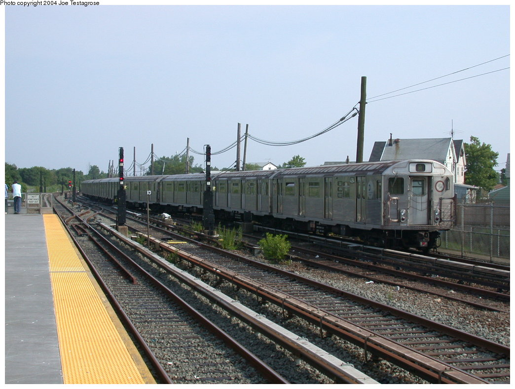 (211k, 1044x788)<br><b>Country:</b> United States<br><b>City:</b> New York<br><b>System:</b> New York City Transit<br><b>Line:</b> IND Rockaway<br><b>Location:</b> Howard Beach <br><b>Route:</b> A<br><b>Car:</b> R-38 (St. Louis, 1966-1967)  4084 <br><b>Photo by:</b> Joe Testagrose<br><b>Date:</b> 7/17/2004<br><b>Viewed (this week/total):</b> 6 / 3652