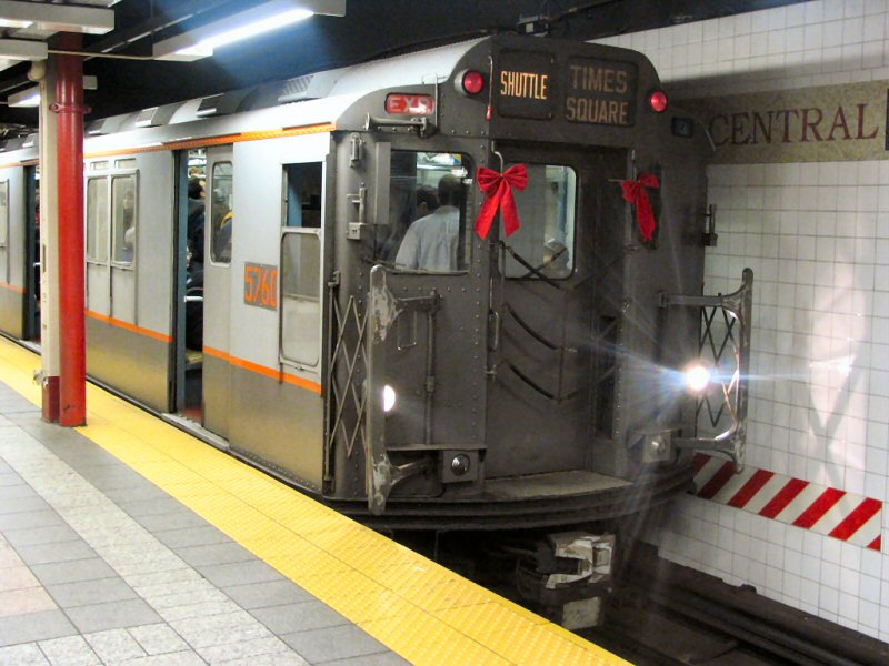 (105k, 800x600)<br><b>Country:</b> United States<br><b>City:</b> New York<br><b>System:</b> New York City Transit<br><b>Line:</b> IRT Times Square-Grand Central Shuttle<br><b>Location:</b> Grand Central <br><b>Route:</b> Fan Trip<br><b>Car:</b> R-12 (American Car & Foundry, 1948) 5760 <br><b>Photo by:</b> Dante D. Angerville<br><b>Date:</b> 12/18/2004<br><b>Notes:</b> Train in regular passenger service, technically not a fan trip.<br><b>Viewed (this week/total):</b> 0 / 3413