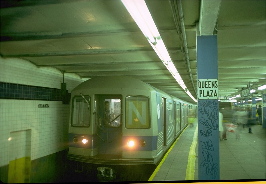 (155k, 1024x710)<br><b>Country:</b> United States<br><b>City:</b> New York<br><b>System:</b> New York City Transit<br><b>Line:</b> IND Queens Boulevard Line<br><b>Location:</b> Queens Plaza <br><b>Route:</b> N<br><b>Car:</b> R-42 (St. Louis, 1969-1970)  4550 <br><b>Photo by:</b> Doug Grotjahn<br><b>Collection of:</b> Joe Testagrose<br><b>Date:</b> 10/20/1976<br><b>Viewed (this week/total):</b> 8 / 3761