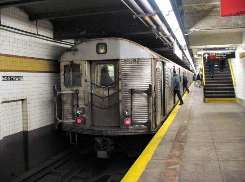 (105k, 800x594)<br><b>Country:</b> United States<br><b>City:</b> New York<br><b>System:</b> New York City Transit<br><b>Line:</b> IND Fulton Street Line<br><b>Location:</b> Nostrand Avenue <br><b>Route:</b> V<br><b>Car:</b> R-32 (Budd, 1964)  3371 <br><b>Photo by:</b> Dante D. Angerville<br><b>Date:</b> 1/25/2004<br><b>Notes:</b> Lower level.<br><b>Viewed (this week/total):</b> 4 / 9353