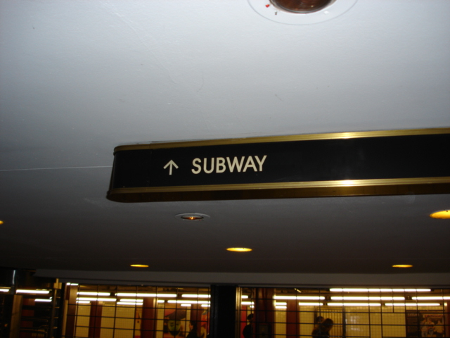 (131k, 640x480)<br><b>Country:</b> United States<br><b>City:</b> New York<br><b>System:</b> New York City Transit<br><b>Line:</b> IND 6th Avenue Line<br><b>Location:</b> 47-50th Street/Rockefeller Center <br><b>Photo by:</b> Kris Naudus<br><b>Date:</b> 1/13/2004<br><b>Notes:</b> Various entryways and signage at Rock. Center.<br><b>Viewed (this week/total):</b> 0 / 2782