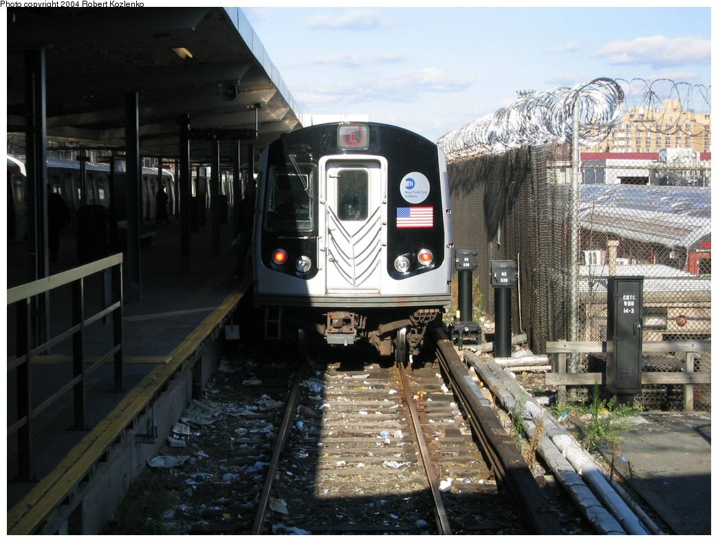 (189k, 1044x788)<br><b>Country:</b> United States<br><b>City:</b> New York<br><b>System:</b> New York City Transit<br><b>Line:</b> BMT Canarsie Line<br><b>Location:</b> Rockaway Parkway <br><b>Route:</b> L<br><b>Car:</b> R-143 (Kawasaki, 2001-2002) 8252 <br><b>Photo by:</b> Robert Kozlenko<br><b>Date:</b> 11/26/2004<br><b>Viewed (this week/total):</b> 2 / 4280
