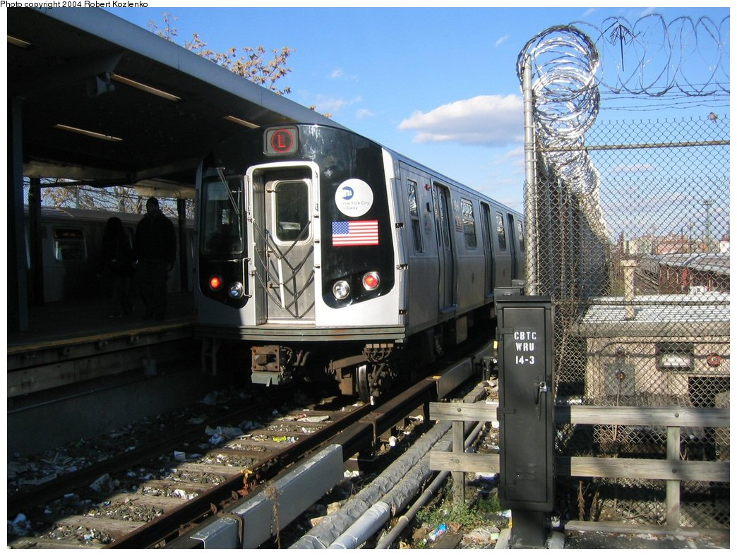 (211k, 1044x788)<br><b>Country:</b> United States<br><b>City:</b> New York<br><b>System:</b> New York City Transit<br><b>Line:</b> BMT Canarsie Line<br><b>Location:</b> Rockaway Parkway <br><b>Route:</b> L<br><b>Car:</b> R-143 (Kawasaki, 2001-2002) 8252 <br><b>Photo by:</b> Robert Kozlenko<br><b>Date:</b> 11/26/2004<br><b>Viewed (this week/total):</b> 5 / 2891