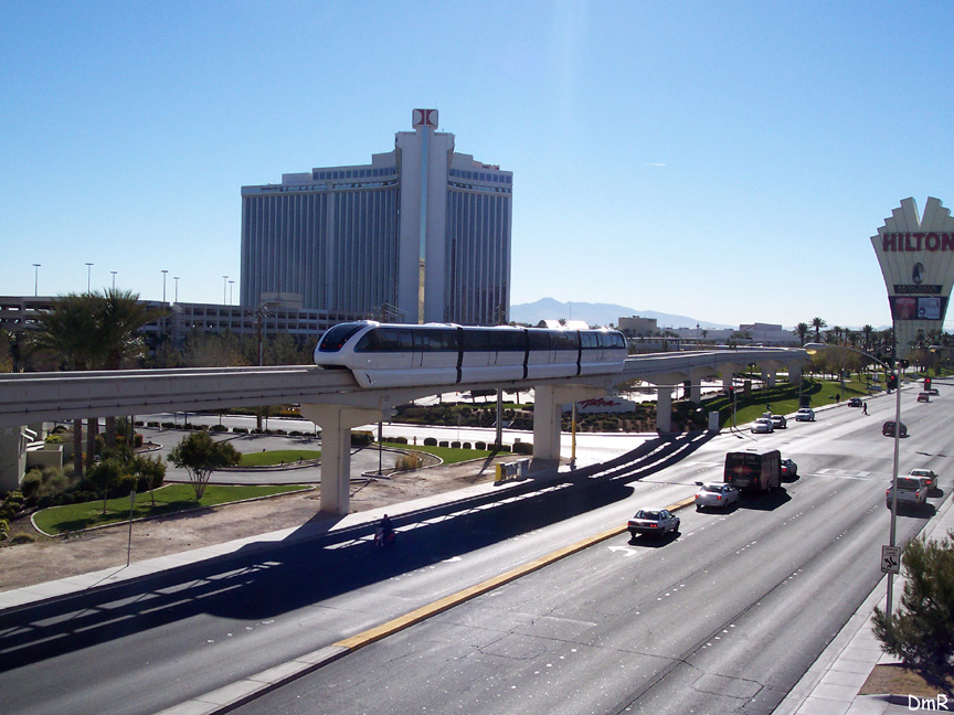 (216k, 864x648)<br><b>Country:</b> United States<br><b>City:</b> Las Vegas, NV<br><b>System:</b> Las Vegas Monorail<br><b>Location:</b> Las Vegas Hilton <br><b>Photo by:</b> D. Reinecke<br><b>Date:</b> 1/13/2005<br><b>Notes:</b> White train on trackway heading to Hilton<br><b>Viewed (this week/total):</b> 1 / 3723