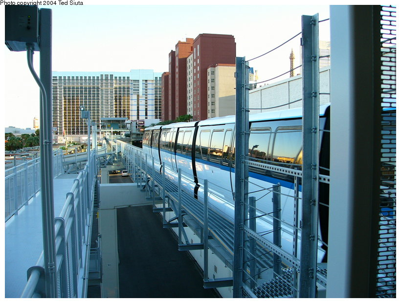 (139k, 820x620)<br><b>Country:</b> United States<br><b>City:</b> Las Vegas, NV<br><b>System:</b> Las Vegas Monorail<br><b>Location:</b> Harrah's/Imperial Palace <br><b>Photo by:</b> Ted Siuta<br><b>Date:</b> 8/27/2004<br><b>Notes:</b> Southbound monorail departing Harrah's.<br><b>Viewed (this week/total):</b> 1 / 1645