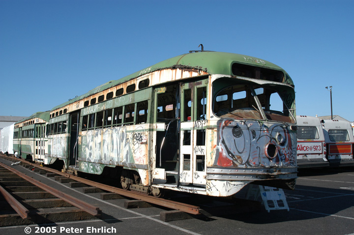 (139k, 720x478)<br><b>Country:</b> United States<br><b>City:</b> San Francisco/Bay Area, CA<br><b>System:</b> SF MUNI<br><b>Location:</b> Marin Division Depot <br><b>Car:</b> SF MUNI PCC Baby Ten (St. Louis Car Co, 1951)  1028/1026 <br><b>Photo by:</b> Peter Ehrlich<br><b>Date:</b> 9/5/2002<br><b>Notes:</b> PCCs 1028, 1026 (and 1027 and 1034) were repurchased from a private party for possible rebuilding.  They are stored at Marin Division.<br><b>Viewed (this week/total):</b> 6 / 3305