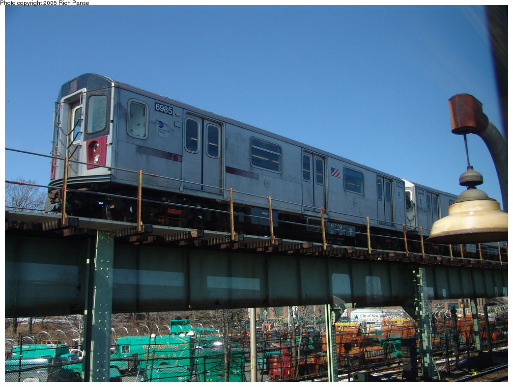 (189k, 1044x788)<br><b>Country:</b> United States<br><b>City:</b> New York<br><b>System:</b> New York City Transit<br><b>Line:</b> IRT White Plains Road Line<br><b>Location:</b> Dyre Flyover<br><b>Route:</b> 5<br><b>Car:</b> R-142 (Option Order, Bombardier, 2002-2003)  6985 <br><b>Photo by:</b> Richard Panse<br><b>Date:</b> 2/27/2005<br><b>Viewed (this week/total):</b> 0 / 4469