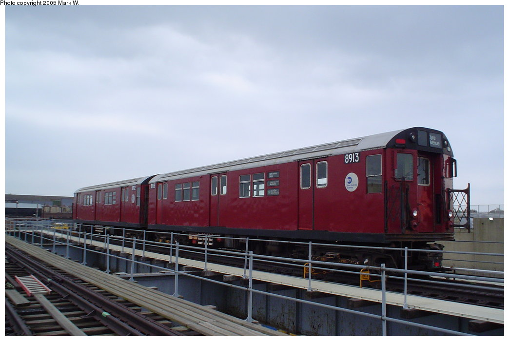 (120k, 1044x700)<br><b>Country:</b> United States<br><b>City:</b> New York<br><b>System:</b> New York City Transit<br><b>Location:</b> MTA Tiffany Iron Works/The Bronx<br><b>Car:</b> R-33 Main Line (St. Louis, 1962-63) 8913 <br><b>Photo by:</b> Mark W.<br><b>Date:</b> 8/17/2003<br><b>Viewed (this week/total):</b> 15 / 6848