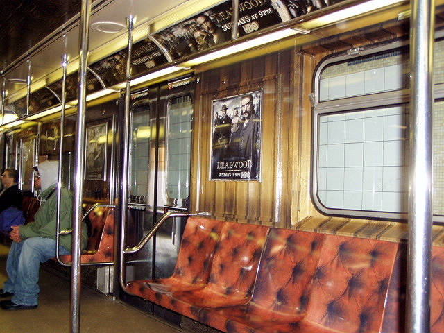 (155k, 640x480)<br><b>Country:</b> United States<br><b>City:</b> New York<br><b>System:</b> New York City Transit<br><b>Line:</b> IRT Times Square-Grand Central Shuttle<br><b>Location:</b> Grand Central <br><b>Route:</b> S<br><b>Car:</b> R-62A (Bombardier, 1984-1987)  1930 <br><b>Photo by:</b> Irwin Markowitz<br><b>Date:</b> 3/11/2005<br><b>Notes:</b> Car dressed up as a promotion for the HBO series <i>Deadwood</i>.<br><b>Viewed (this week/total):</b> 0 / 6552