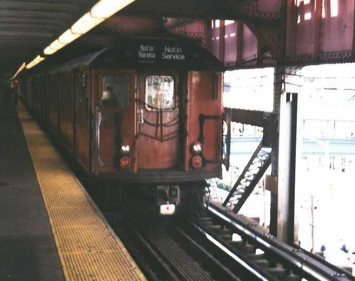(33k, 690x546)<br><b>Country:</b> United States<br><b>City:</b> New York<br><b>System:</b> New York City Transit<br><b>Line:</b> IRT Flushing Line<br><b>Location:</b> Queensborough Plaza <br><b>Route:</b> Work Service<br><b>Car:</b> R-33 World's Fair (St. Louis, 1963-64) 9335 <br><b>Photo by:</b> Gary Chatterton<br><b>Date:</b> 9/2003<br><b>Viewed (this week/total):</b> 1 / 2685