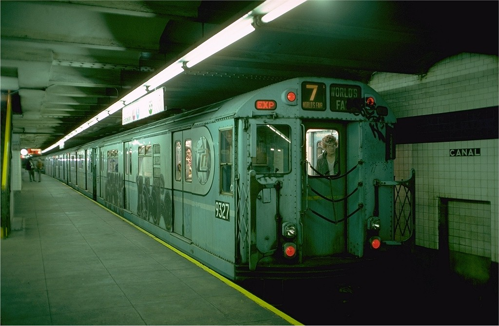(173k, 1024x669)<br><b>Country:</b> United States<br><b>City:</b> New York<br><b>System:</b> New York City Transit<br><b>Line:</b> IND 8th Avenue Line<br><b>Location:</b> Canal Street-Holland Tunnel <br><b>Route:</b> Fan Trip<br><b>Car:</b> R-33 World's Fair (St. Louis, 1963-64) 9327 <br><b>Photo by:</b> Doug Grotjahn<br><b>Collection of:</b> Joe Testagrose<br><b>Date:</b> 11/27/1976<br><b>Viewed (this week/total):</b> 3 / 3640