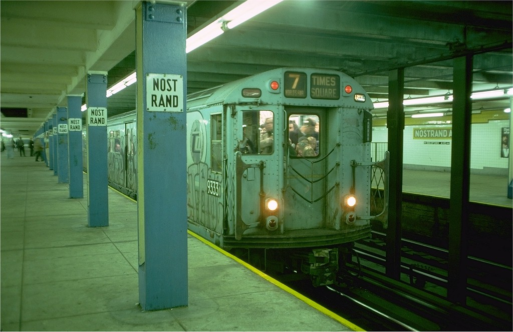 (165k, 1024x663)<br><b>Country:</b> United States<br><b>City:</b> New York<br><b>System:</b> New York City Transit<br><b>Line:</b> IND Fulton Street Line<br><b>Location:</b> Nostrand Avenue <br><b>Route:</b> Fan Trip<br><b>Car:</b> R-33 World's Fair (St. Louis, 1963-64) 9333 <br><b>Photo by:</b> Doug Grotjahn<br><b>Collection of:</b> Joe Testagrose<br><b>Date:</b> 11/27/1976<br><b>Notes:</b> Upper level.<br><b>Viewed (this week/total):</b> 4 / 3921