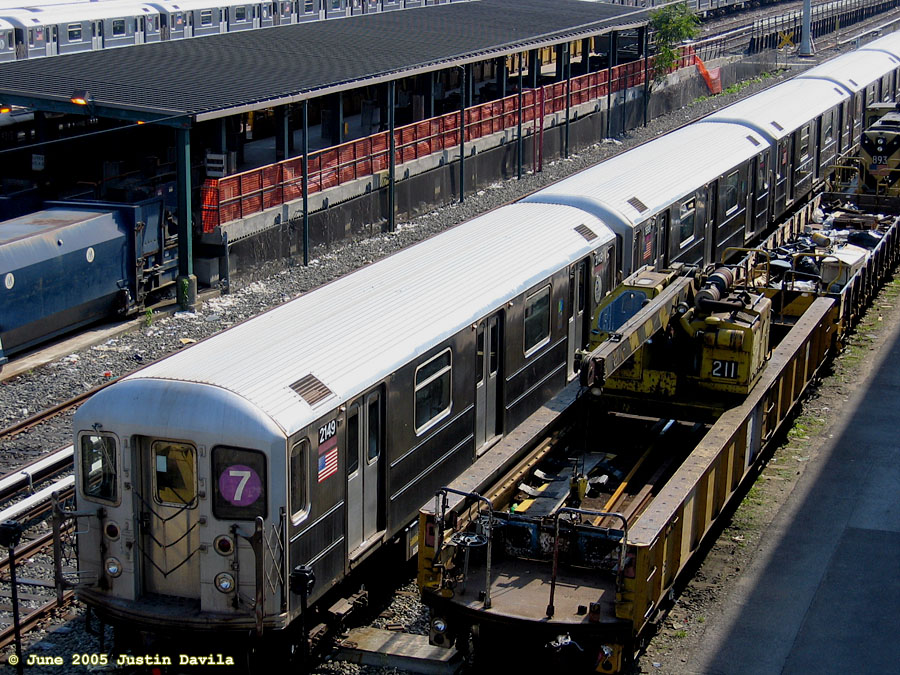 (251k, 900x675)<br><b>Country:</b> United States<br><b>City:</b> New York<br><b>System:</b> New York City Transit<br><b>Location:</b> Corona Yard<br><b>Car:</b> R-62A (Bombardier, 1984-1987)  2149 <br><b>Photo by:</b> Justin Davila<br><b>Date:</b> 6/8/2005<br><b>Notes:</b> With Crane Car 211.<br><b>Viewed (this week/total):</b> 0 / 2793