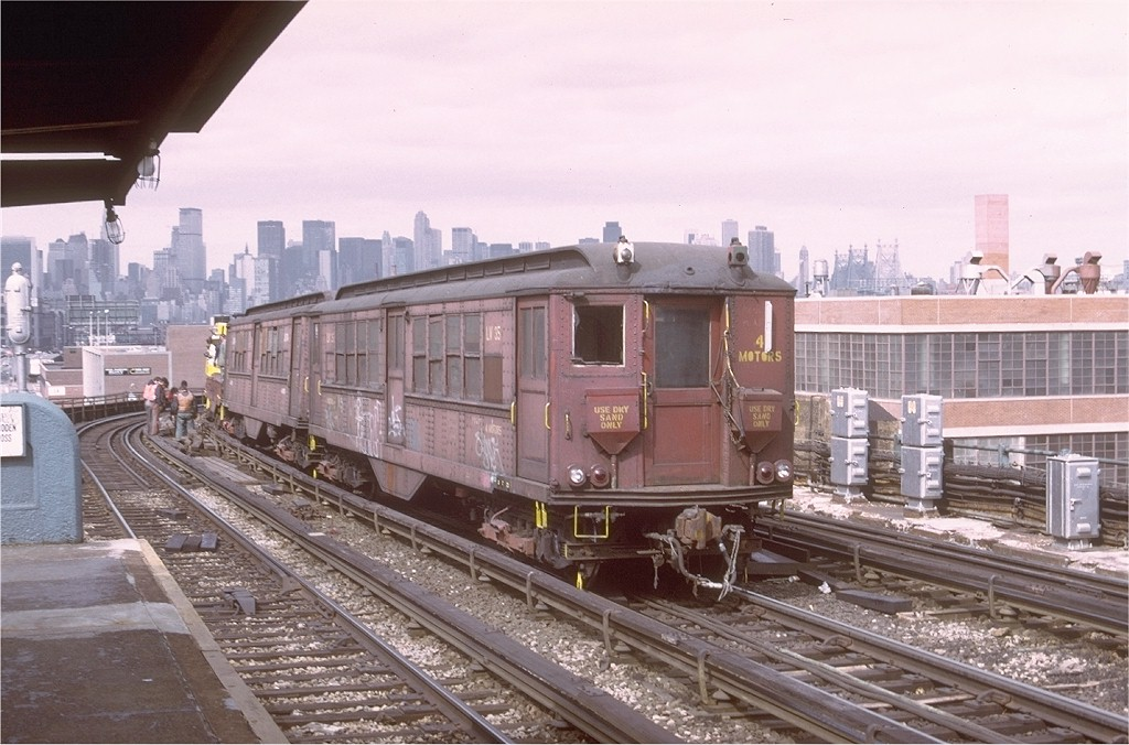 (196k, 1024x676)<br><b>Country:</b> United States<br><b>City:</b> New York<br><b>System:</b> New York City Transit<br><b>Line:</b> IRT Flushing Line<br><b>Location:</b> 33rd Street/Rawson Street <br><b>Car:</b> Low-V LV35 (ex-5485)<br><b>Photo by:</b> Ed McKernan<br><b>Collection of:</b> Joe Testagrose<br><b>Date:</b> 4/1975<br><b>Viewed (this week/total):</b> 0 / 2529