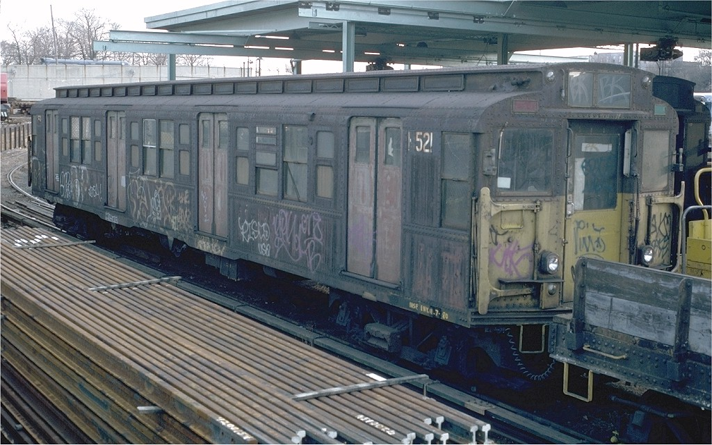 (211k, 1024x640)<br><b>Country:</b> United States<br><b>City:</b> New York<br><b>System:</b> New York City Transit<br><b>Location:</b> 36th Street Yard<br><b>Car:</b> R-1 (American Car & Foundry, 1930-1931) M521 (ex-377)<br><b>Photo by:</b> Doug Grotjahn<br><b>Collection of:</b> Joe Testagrose<br><b>Date:</b> 12/14/1980<br><b>Viewed (this week/total):</b> 2 / 2863