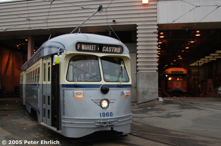 (142k, 720x478)<br><b>Country:</b> United States<br><b>City:</b> San Francisco/Bay Area, CA<br><b>System:</b> SF MUNI<br><b>Location:</b> Geneva Yard <br><b>Car:</b> SF MUNI PCC (Ex-SEPTA) (St. Louis Car Co., 1947-1948)  1060/1080 <br><b>Photo by:</b> Peter Ehrlich<br><b>Date:</b> 5/26/2005<br><b>Notes:</b> Geneva Yard, first day of 1060's return to service, with PCC 1080 (Los Angeles Transit Lines); the first of the ex-Newark PCCs, inside the shop building.<br><b>Viewed (this week/total):</b> 2 / 1334