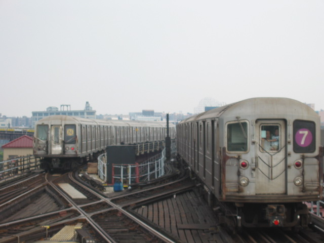 (67k, 640x480)<br><b>Country:</b> United States<br><b>City:</b> New York<br><b>System:</b> New York City Transit<br><b>Line:</b> BMT Astoria Line<br><b>Location:</b> Queensborough Plaza <br><b>Route:</b> N<br><b>Car:</b> R-40 (St. Louis, 1968)   <br><b>Photo by:</b> Oren H.<br><b>Date:</b> 6/27/2003<br><b>Notes:</b> w/R62A on #7 leaving Queensboro Plaza<br><b>Viewed (this week/total):</b> 0 / 4243