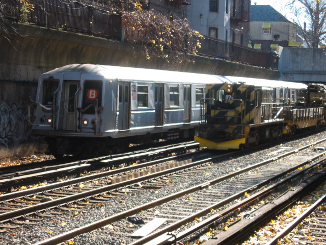 (165k, 640x480)<br><b>Country:</b> United States<br><b>City:</b> New York<br><b>System:</b> New York City Transit<br><b>Line:</b> BMT Brighton Line<br><b>Location:</b> Cortelyou Road <br><b>Route:</b> B<br><b>Car:</b> R-40 (St. Louis, 1968)  4212 <br><b>Photo by:</b> Oren H.<br><b>Date:</b> 11/26/2004<br><b>Notes:</b> w/Locomotive R77 894<br><b>Viewed (this week/total):</b> 4 / 4018