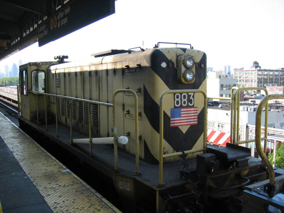(81k, 909x682)<br><b>Country:</b> United States<br><b>City:</b> New York<br><b>System:</b> New York City Transit<br><b>Line:</b> BMT Astoria Line<br><b>Location:</b> Queensborough Plaza <br><b>Car:</b> R-77 Locomotive  883 <br><b>Photo by:</b> Robbie Rosenfeld<br><b>Date:</b> 7/10/2005<br><b>Viewed (this week/total):</b> 0 / 2861