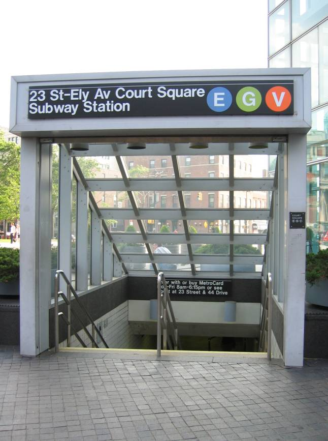 (78k, 646x867)<br><b>Country:</b> United States<br><b>City:</b> New York<br><b>System:</b> New York City Transit<br><b>Line:</b> IND Queens Boulevard Line<br><b>Location:</b> Court Square/23rd St (Ely Avenue) <br><b>Photo by:</b> Robbie Rosenfeld<br><b>Date:</b> 7/11/2005<br><b>Notes:</b> Station entrance.<br><b>Viewed (this week/total):</b> 2 / 5483