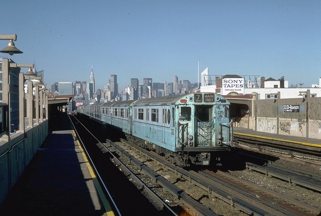 (216k, 1024x691)<br><b>Country:</b> United States<br><b>City:</b> New York<br><b>System:</b> New York City Transit<br><b>Line:</b> IRT Flushing Line<br><b>Location:</b> 33rd Street/Rawson Street <br><b>Route:</b> 7<br><b>Car:</b> R-33 World's Fair (St. Louis, 1963-64) 9309 <br><b>Photo by:</b> Steve Zabel<br><b>Collection of:</b> Joe Testagrose<br><b>Date:</b> 11/3/1981<br><b>Viewed (this week/total):</b> 0 / 3528