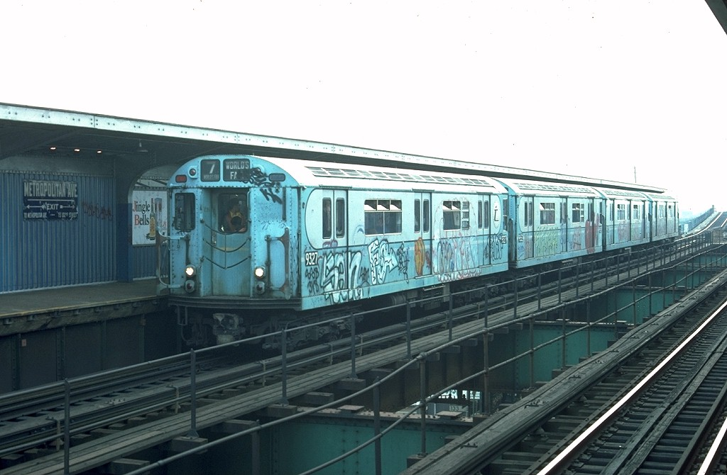 (158k, 1024x670)<br><b>Country:</b> United States<br><b>City:</b> New York<br><b>System:</b> New York City Transit<br><b>Line:</b> BMT Nassau Street/Jamaica Line<br><b>Location:</b> Metropolitan Avenue (Demolished) <br><b>Route:</b> Fan Trip<br><b>Car:</b> R-33 World's Fair (St. Louis, 1963-64) 9327 <br><b>Photo by:</b> Joe Testagrose<br><b>Date:</b> 11/27/1976<br><b>Viewed (this week/total):</b> 3 / 6204