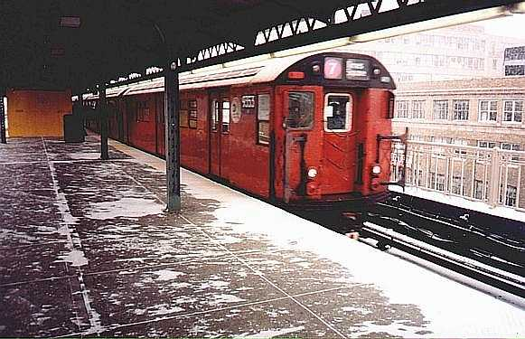 (47k, 581x375)<br><b>Country:</b> United States<br><b>City:</b> New York<br><b>System:</b> New York City Transit<br><b>Line:</b> IRT Flushing Line<br><b>Location:</b> Queensborough Plaza <br><b>Route:</b> 7<br><b>Car:</b> R-36 World's Fair (St. Louis, 1963-64) 9353 <br><b>Photo by:</b> Trevor Logan<br><b>Date:</b> 1999<br><b>Viewed (this week/total):</b> 6 / 2945