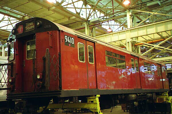 (129k, 600x400)<br><b>Country:</b> United States<br><b>City:</b> New York<br><b>System:</b> New York City Transit<br><b>Location:</b> Coney Island Shop/Overhaul & Repair Shop<br><b>Car:</b> R-36 World's Fair (St. Louis, 1963-64) 9410 <br><b>Photo by:</b> Sidney Keyles<br><b>Date:</b> 5/22/1999<br><b>Notes:</b> Mate is outside on museum track<br><b>Viewed (this week/total):</b> 3 / 5610
