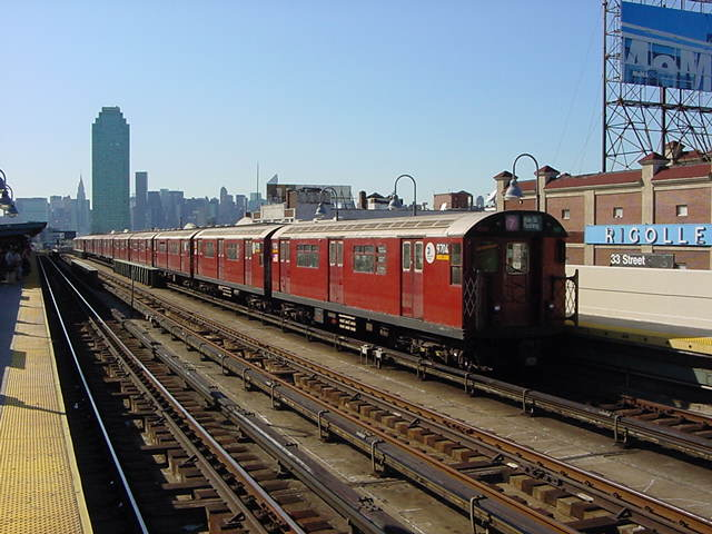 (60k, 640x480)<br><b>Country:</b> United States<br><b>City:</b> New York<br><b>System:</b> New York City Transit<br><b>Line:</b> IRT Flushing Line<br><b>Location:</b> 33rd Street/Rawson Street <br><b>Route:</b> 7<br><b>Car:</b> R-36 World's Fair (St. Louis, 1963-64) 9704 <br><b>Photo by:</b> Salaam Allah<br><b>Date:</b> 9/17/2002<br><b>Viewed (this week/total):</b> 1 / 3198