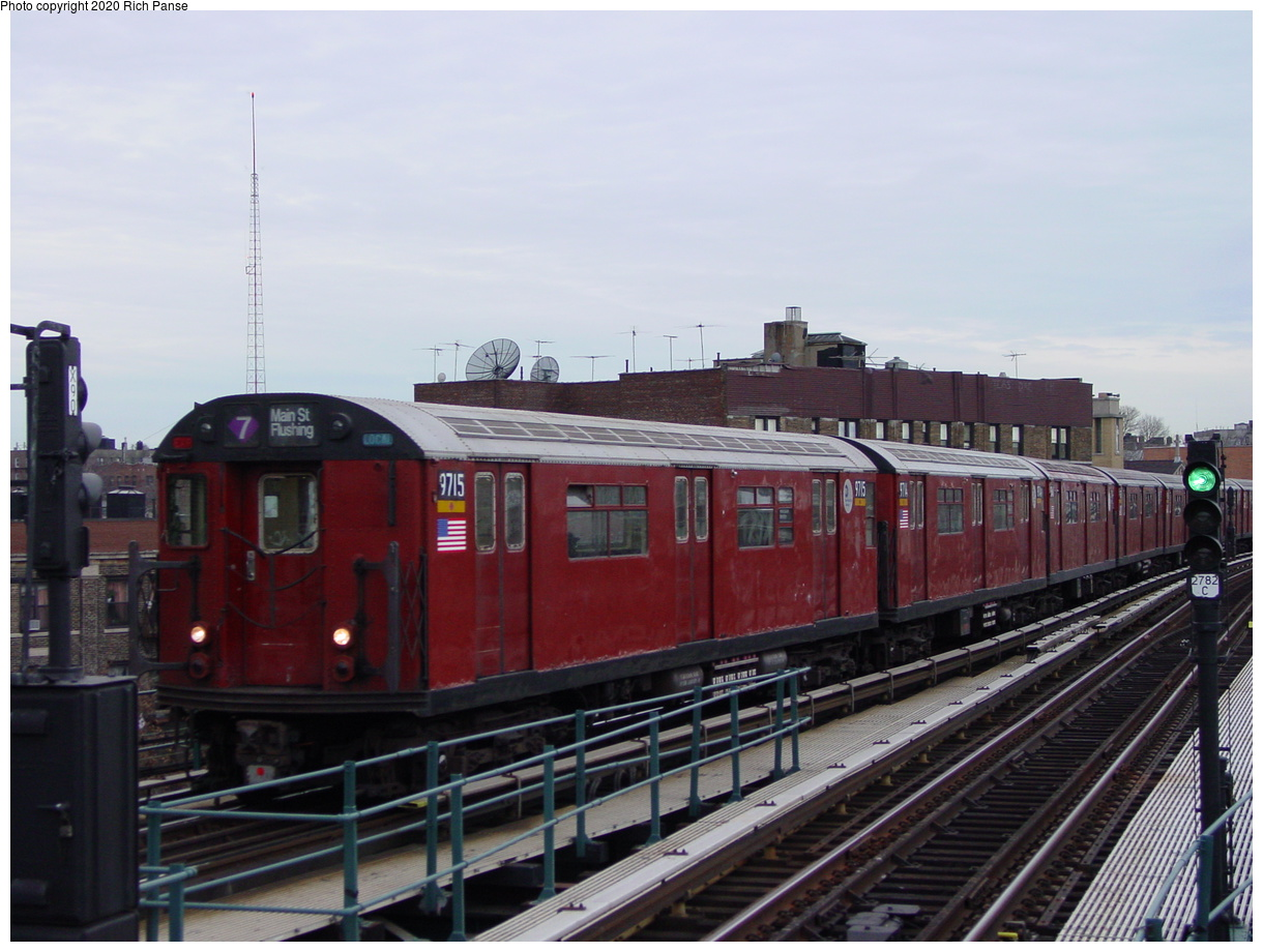 (69k, 820x620)<br><b>Country:</b> United States<br><b>City:</b> New York<br><b>System:</b> New York City Transit<br><b>Line:</b> IRT Flushing Line<br><b>Location:</b> 61st Street/Woodside <br><b>Route:</b> 7<br><b>Car:</b> R-36 World's Fair (St. Louis, 1963-64) 9715 <br><b>Photo by:</b> Richard Panse<br><b>Date:</b> 1/23/2002<br><b>Viewed (this week/total):</b> 2 / 2653