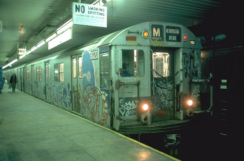 (178k, 1024x676)<br><b>Country:</b> United States<br><b>City:</b> New York<br><b>System:</b> New York City Transit<br><b>Location:</b> DeKalb Avenue<br><b>Route:</b> M<br><b>Car:</b> R-27 (St. Louis, 1960)  8020 <br><b>Photo by:</b> Doug Grotjahn<br><b>Collection of:</b> Joe Testagrose<br><b>Date:</b> 10/6/1976<br><b>Viewed (this week/total):</b> 13 / 7466