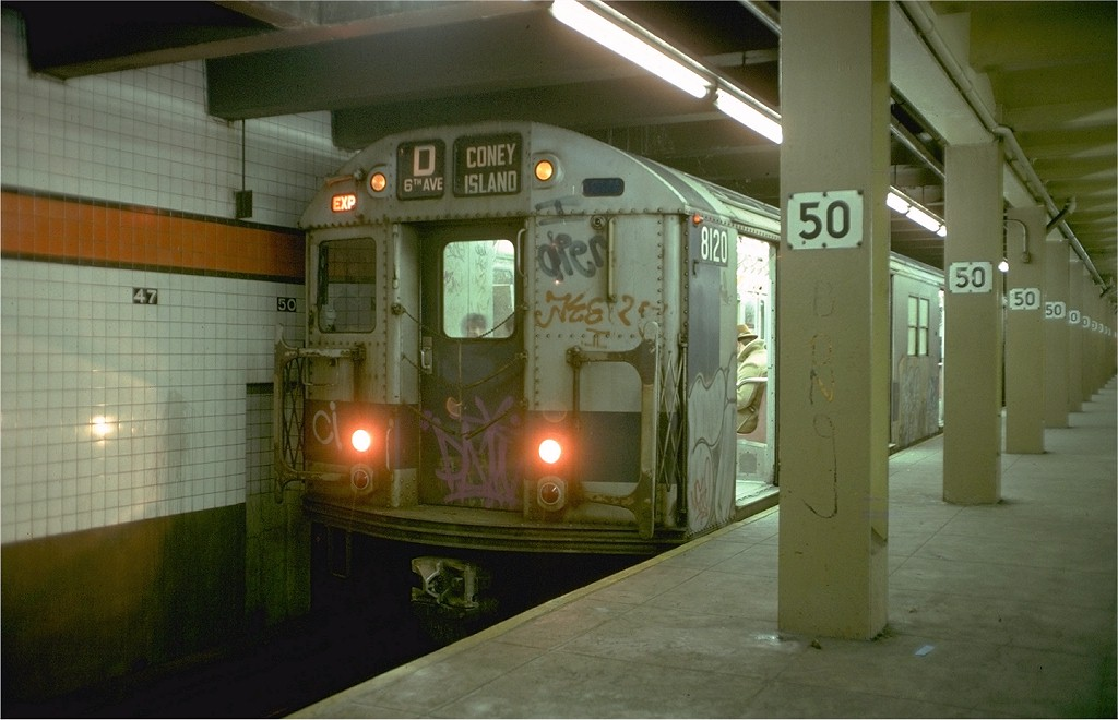 (155k, 1024x660)<br><b>Country:</b> United States<br><b>City:</b> New York<br><b>System:</b> New York City Transit<br><b>Line:</b> IND 6th Avenue Line<br><b>Location:</b> 47-50th Street/Rockefeller Center <br><b>Route:</b> D<br><b>Car:</b> R-27 (St. Louis, 1960)  8120 <br><b>Photo by:</b> Doug Grotjahn<br><b>Collection of:</b> Joe Testagrose<br><b>Date:</b> 1/28/1978<br><b>Viewed (this week/total):</b> 2 / 5923