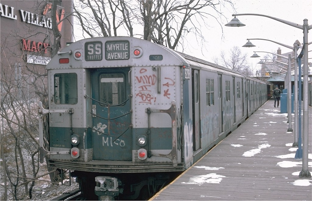 (216k, 1024x660)<br><b>Country:</b> United States<br><b>City:</b> New York<br><b>System:</b> New York City Transit<br><b>Line:</b> BMT Myrtle Avenue Line<br><b>Location:</b> Metropolitan Avenue <br><b>Route:</b> M<br><b>Car:</b> R-27 (St. Louis, 1960)  8208 <br><b>Photo by:</b> Ed McKernan<br><b>Collection of:</b> Joe Testagrose<br><b>Date:</b> 12/21/1975<br><b>Viewed (this week/total):</b> 1 / 5066