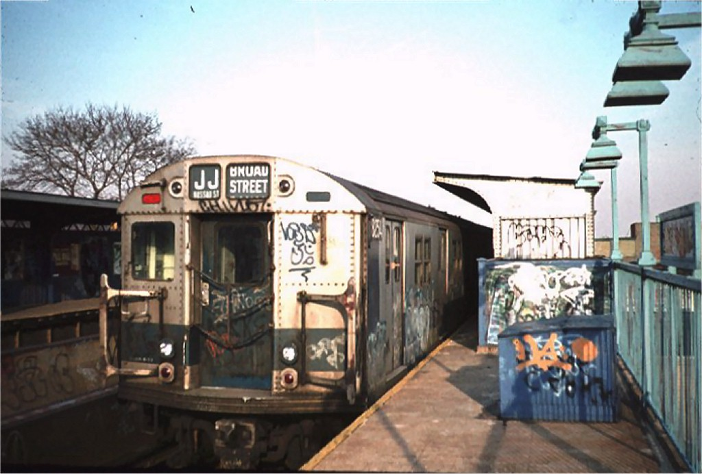 (148k, 1024x692)<br><b>Country:</b> United States<br><b>City:</b> New York<br><b>System:</b> New York City Transit<br><b>Line:</b> BMT Nassau Street/Jamaica Line<br><b>Location:</b> 75th Street/Elderts Lane <br><b>Route:</b> J<br><b>Car:</b> R-30 (St. Louis, 1961) 8254 <br><b>Photo by:</b> Joe Gorycki<br><b>Collection of:</b> Joe Testagrose<br><b>Date:</b> 3/1977<br><b>Viewed (this week/total):</b> 3 / 4686