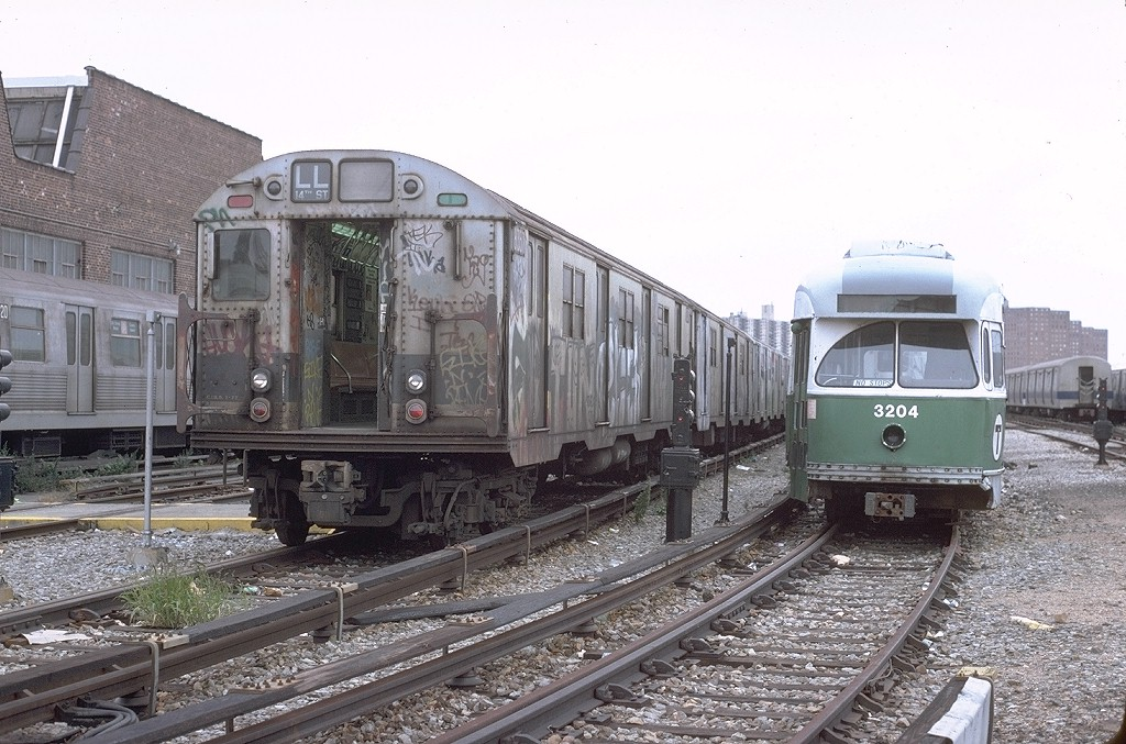 (223k, 1024x677)<br><b>Country:</b> United States<br><b>City:</b> New York<br><b>System:</b> New York City Transit<br><b>Location:</b> Coney Island Yard<br><b>Car:</b> R-30 (St. Louis, 1961) 8357 <br><b>Photo by:</b> Steve Zabel<br><b>Collection of:</b> Joe Testagrose<br><b>Date:</b> 10/13/1979<br><b>Notes:</b> With MBTA PCC 3204<br><b>Viewed (this week/total):</b> 4 / 4959