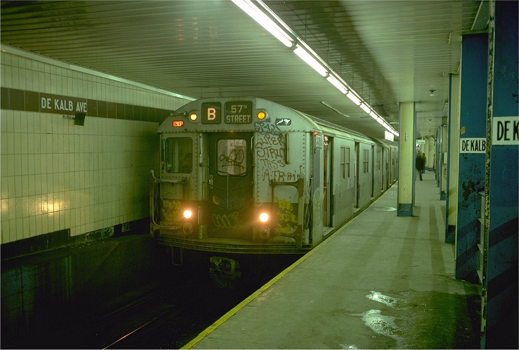 (194k, 1024x691)<br><b>Country:</b> United States<br><b>City:</b> New York<br><b>System:</b> New York City Transit<br><b>Location:</b> DeKalb Avenue<br><b>Route:</b> B<br><b>Car:</b> R-30 (St. Louis, 1961) 8372 <br><b>Photo by:</b> Doug Grotjahn<br><b>Collection of:</b> Joe Testagrose<br><b>Date:</b> 1/4/1977<br><b>Viewed (this week/total):</b> 5 / 6197