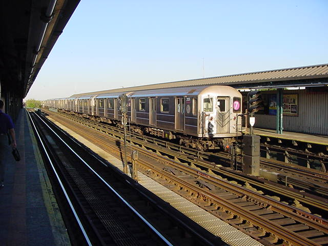 (60k, 640x480)<br><b>Country:</b> United States<br><b>City:</b> New York<br><b>System:</b> New York City Transit<br><b>Line:</b> IRT Flushing Line<br><b>Location:</b> 52nd Street/Lincoln Avenue <br><b>Route:</b> 7<br><b>Car:</b> R-62A (Bombardier, 1984-1987)  2035 <br><b>Photo by:</b> Salaam Allah<br><b>Date:</b> 9/18/2002<br><b>Viewed (this week/total):</b> 0 / 2327