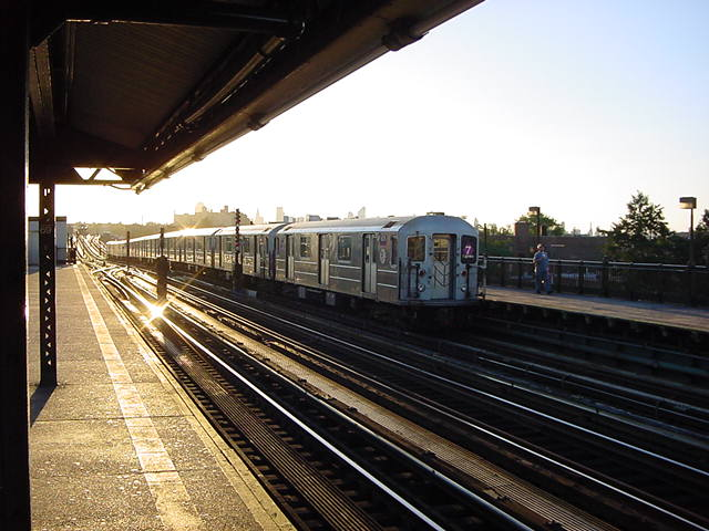 (61k, 640x480)<br><b>Country:</b> United States<br><b>City:</b> New York<br><b>System:</b> New York City Transit<br><b>Line:</b> IRT Flushing Line<br><b>Location:</b> 69th Street/Fisk Avenue <br><b>Route:</b> 7<br><b>Car:</b> R-62A (Bombardier, 1984-1987)   <br><b>Photo by:</b> Salaam Allah<br><b>Date:</b> 9/18/2002<br><b>Viewed (this week/total):</b> 3 / 1635