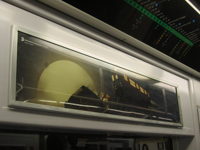 (80k, 640x480)<br><b>Country:</b> United States<br><b>City:</b> New York<br><b>System:</b> New York City Transit<br><b>Photo by:</b> Oren H.<br><b>Artwork:</b> <i>Redbird In Air</i>, John Blackford.<br><b>Notes:</b> Subway art card placed in the R142/R143 fleet of subway cars.<br><b>Viewed (this week/total):</b> 2 / 3439