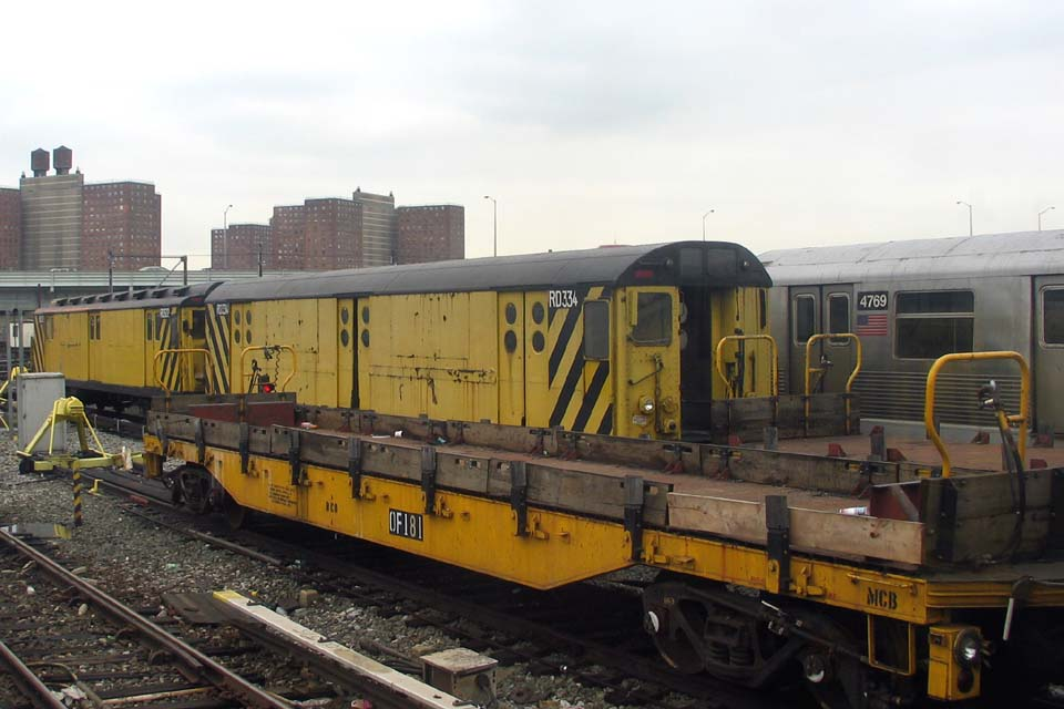 (90k, 960x640)<br><b>Country:</b> United States<br><b>City:</b> New York<br><b>System:</b> New York City Transit<br><b>Location:</b> Coney Island Yard<br><b>Car:</b> R-71 Rider Car (R-17/R-21/R-22 Rebuilds)  RD334 (ex-5984)<br><b>Photo by:</b> Michael Pompili<br><b>Date:</b> 4/3/2004<br><b>Notes:</b> With RD322<br><b>Viewed (this week/total):</b> 0 / 2318