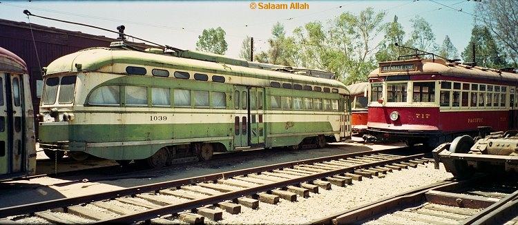 (232k, 750x326)<br><b>Country:</b> United States<br><b>City:</b> Perris, CA<br><b>System:</b> Orange Empire Railway Museum <br><b>Car:</b> SF MUNI PCC Baby Ten (St. Louis Car Co, 1951)  1039 <br><b>Photo by:</b> Salaam Allah<br><b>Date:</b> 1/18/1999<br><b>Viewed (this week/total):</b> 0 / 2628