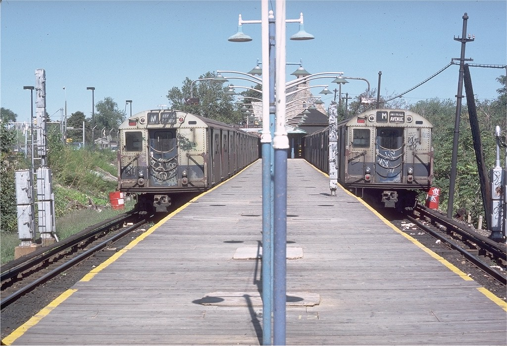 (254k, 1024x699)<br><b>Country:</b> United States<br><b>City:</b> New York<br><b>System:</b> New York City Transit<br><b>Line:</b> BMT Myrtle Avenue Line<br><b>Location:</b> Metropolitan Avenue <br><b>Route:</b> M<br><b>Car:</b> R-30 (St. Louis, 1961) 8394 <br><b>Photo by:</b> Doug Grotjahn<br><b>Collection of:</b> Joe Testagrose<br><b>Date:</b> 9/9/1979<br><b>Viewed (this week/total):</b> 3 / 4029