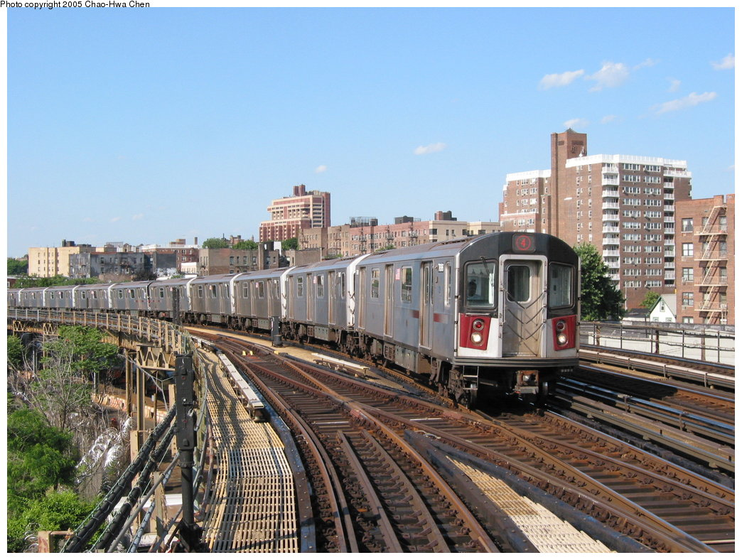 (221k, 1044x788)<br><b>Country:</b> United States<br><b>City:</b> New York<br><b>System:</b> New York City Transit<br><b>Line:</b> IRT Woodlawn Line<br><b>Location:</b> Bedford Park Boulevard <br><b>Route:</b> 4<br><b>Car:</b> R-142A (Option Order, Kawasaki, 2002-2003)  7696 <br><b>Photo by:</b> Chao-Hwa Chen<br><b>Date:</b> 7/1/2003<br><b>Viewed (this week/total):</b> 0 / 2335