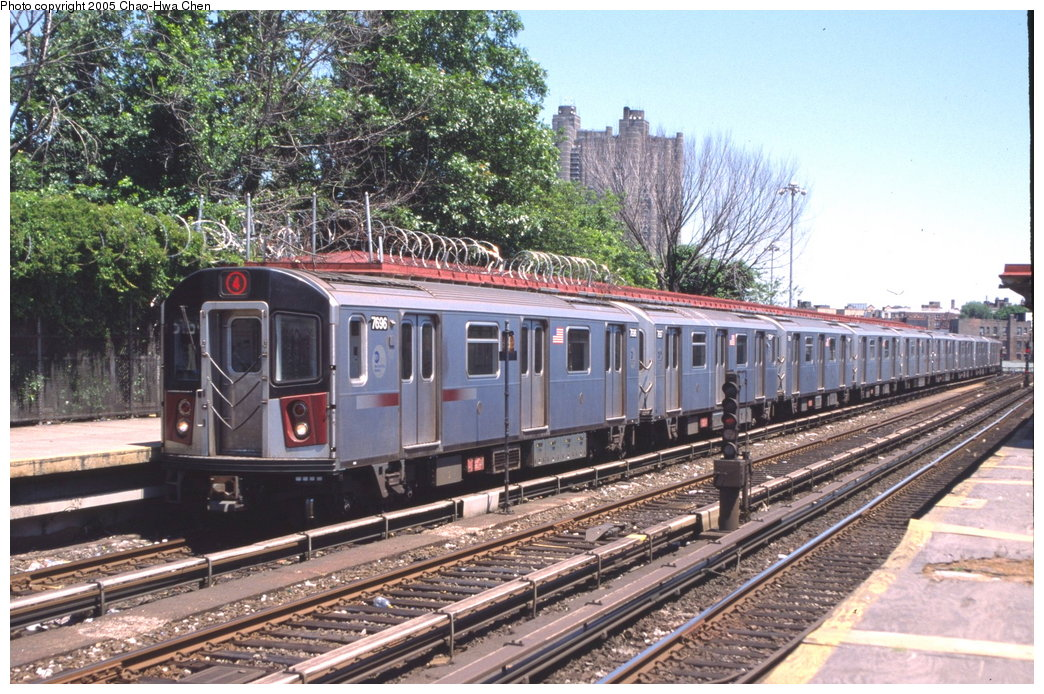 (230k, 1044x694)<br><b>Country:</b> United States<br><b>City:</b> New York<br><b>System:</b> New York City Transit<br><b>Line:</b> IRT Woodlawn Line<br><b>Location:</b> Bedford Park Boulevard <br><b>Route:</b> 4<br><b>Car:</b> R-142A (Option Order, Kawasaki, 2002-2003)  7696 <br><b>Photo by:</b> Chao-Hwa Chen<br><b>Date:</b> 7/1/2003<br><b>Viewed (this week/total):</b> 0 / 2968