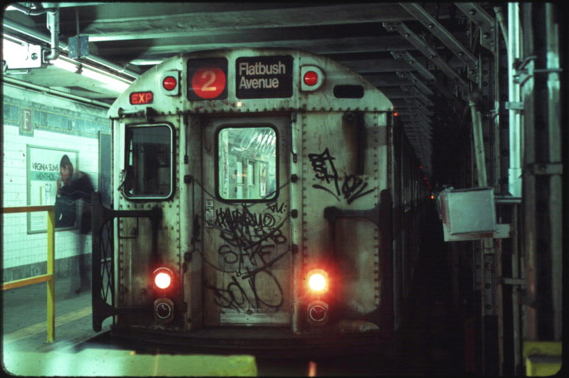 (306k, 820x545)<br><b>Country:</b> United States<br><b>City:</b> New York<br><b>System:</b> New York City Transit<br><b>Line:</b> IRT Brooklyn Line<br><b>Location:</b> Flatbush Avenue <br><b>Route:</b> 2<br><b>Car:</b> R-28 (American Car & Foundry, 1960-61) 7938 <br><b>Photo by:</b> Eric Oszustowicz<br><b>Collection of:</b> Michael Pompili<br><b>Date:</b> 12/2/1986<br><b>Viewed (this week/total):</b> 1 / 7746