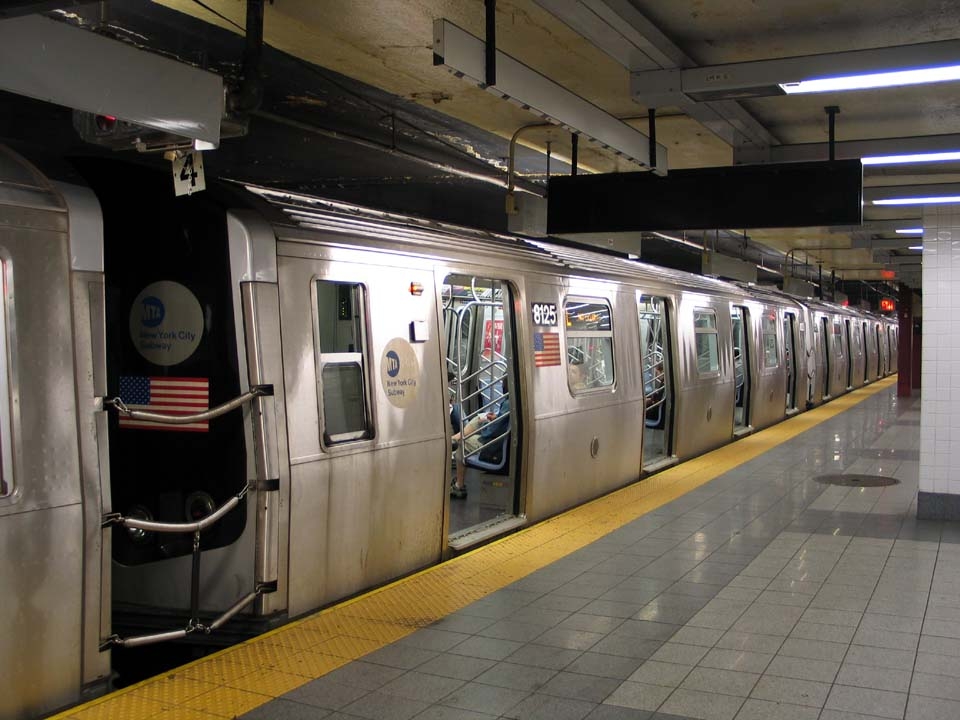 (105k, 960x720)<br><b>Country:</b> United States<br><b>City:</b> New York<br><b>System:</b> New York City Transit<br><b>Line:</b> BMT Canarsie Line<br><b>Location:</b> 8th Avenue <br><b>Route:</b> L<br><b>Car:</b> R-143 (Kawasaki, 2001-2002) 8125 <br><b>Photo by:</b> Michael Pompili<br><b>Date:</b> 4/18/2004<br><b>Viewed (this week/total):</b> 1 / 3113