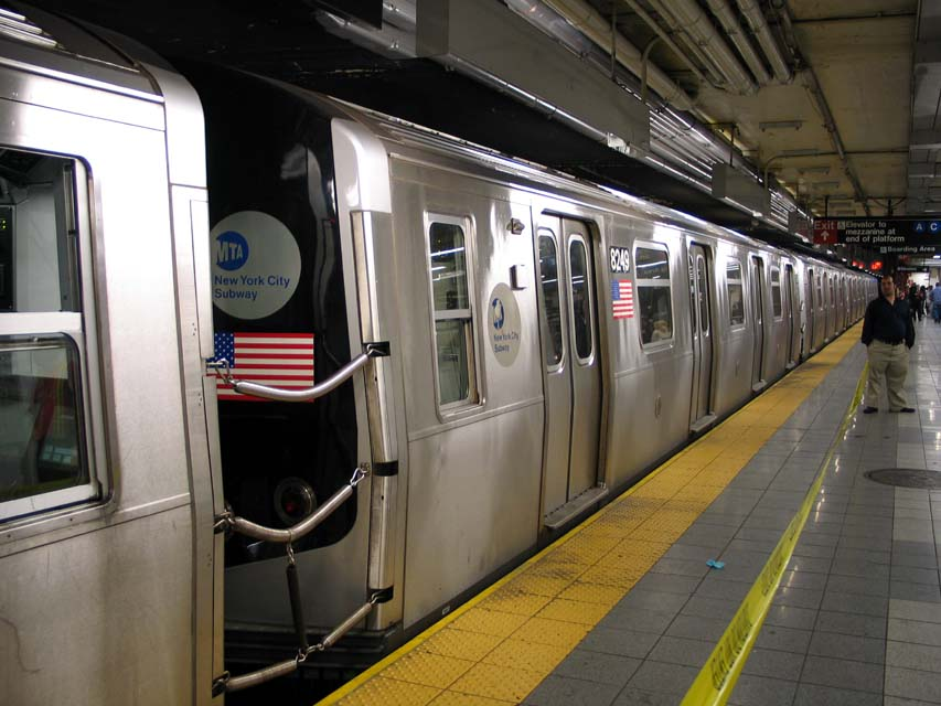 (94k, 853x640)<br><b>Country:</b> United States<br><b>City:</b> New York<br><b>System:</b> New York City Transit<br><b>Line:</b> BMT Canarsie Line<br><b>Location:</b> 8th Avenue <br><b>Route:</b> L<br><b>Car:</b> R-143 (Kawasaki, 2001-2002) 8249 <br><b>Photo by:</b> Michael Pompili<br><b>Date:</b> 4/18/2004<br><b>Viewed (this week/total):</b> 0 / 2770