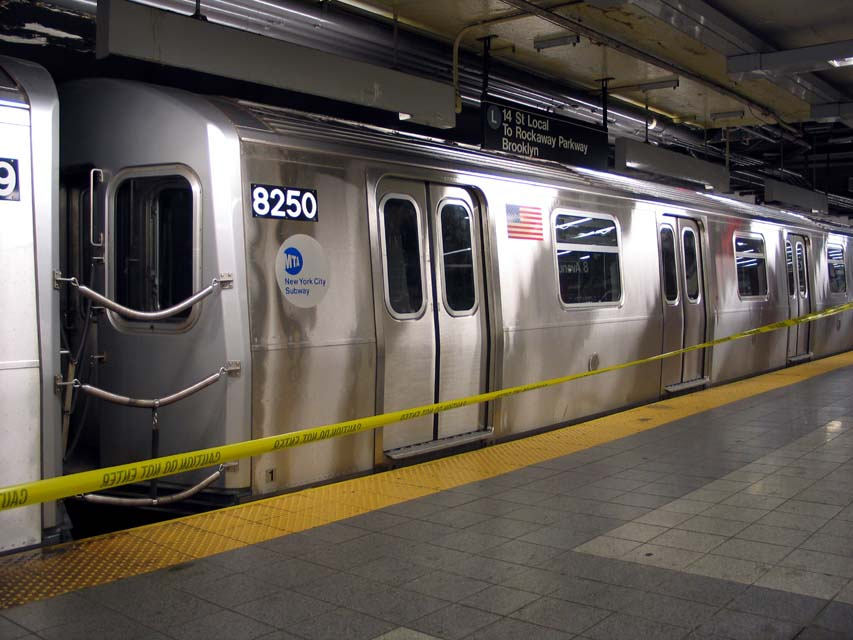 (92k, 853x640)<br><b>Country:</b> United States<br><b>City:</b> New York<br><b>System:</b> New York City Transit<br><b>Line:</b> BMT Canarsie Line<br><b>Location:</b> 8th Avenue <br><b>Route:</b> L<br><b>Car:</b> R-143 (Kawasaki, 2001-2002) 8250 <br><b>Photo by:</b> Michael Pompili<br><b>Date:</b> 4/18/2004<br><b>Viewed (this week/total):</b> 0 / 3895