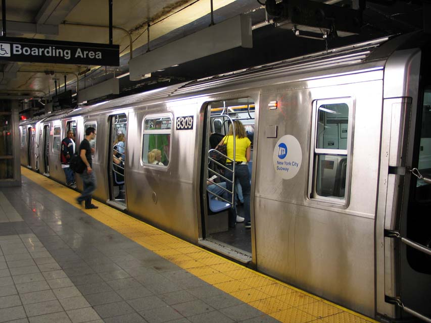 (93k, 853x640)<br><b>Country:</b> United States<br><b>City:</b> New York<br><b>System:</b> New York City Transit<br><b>Line:</b> BMT Canarsie Line<br><b>Location:</b> 8th Avenue <br><b>Route:</b> L<br><b>Car:</b> R-143 (Kawasaki, 2001-2002) 8309 <br><b>Photo by:</b> Michael Pompili<br><b>Date:</b> 4/18/2004<br><b>Viewed (this week/total):</b> 0 / 3948
